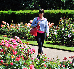 © Licensed to London News Pictures. 09/06/2016<br /> A lady enjoing a walk in the Greenwich Park Rose Garden.<br /> Sunny weather in Greenwich Park,Greenwich,London  today (09/06/2016) <br /> <br /> <br /> <br /> (Byline:Grant Falvey/LNP)