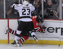 June 9, 2012; Newark, NJ, USA;  Los Angeles Kings right wing Dustin Brown (23) hits New Jersey Devils right wing Petr Sykora (15)during the first period of Game 5 of the 2012 Stanley Cup Finals at the Prudential Center.