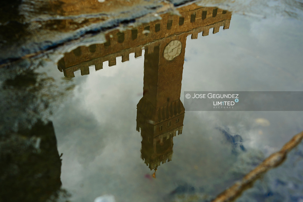 Reflection Of Palazzo Vecchio On Puddle in Firenze