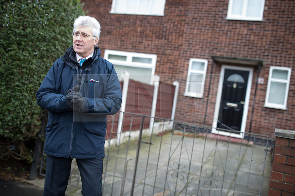 © Licensed to London News Pictures . 01/02/2014 . Manchester , UK . JOHN BICKLEY in front of the house where he spent the first few years of his life , on Peterswood Close in Wythenshawe . Nigel Farage , the leader of the UK Independence Party ( UKIP ) joins candidate John Bickley on the campaign trail ahead of the Wythenshawe and Sale East by-election , following the death of MP Paul Goggins . Photo credit : Joel Goodman/LNP