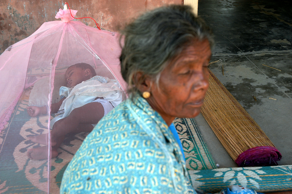 A woman with her grandchild displaced by the December 26, 2004 Tsunami that struck S.E. Asia living at the Sakkoddai Catholic School..Sakkoddai, Point Pedro, Sri Lanka. 14/01/2005.Photo © J.B. Russell
