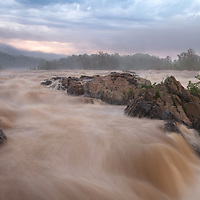 Stormy sunset over the swollen Potomac River at Great Falls, Great Falls National Park, VA.