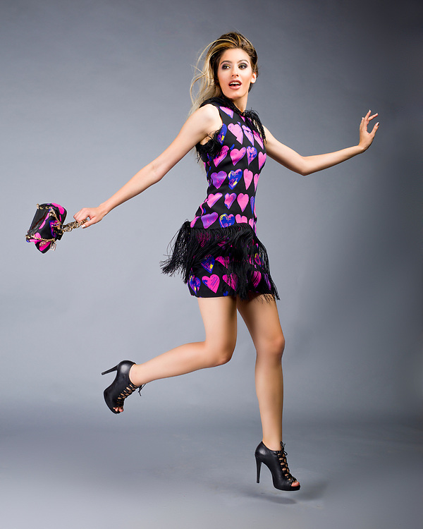 Studio fashion photo of model jumping in Versace dress. Fashion photo by Gerard Harrison, Image Theory Photoworks.  Model Elodie Tusac.