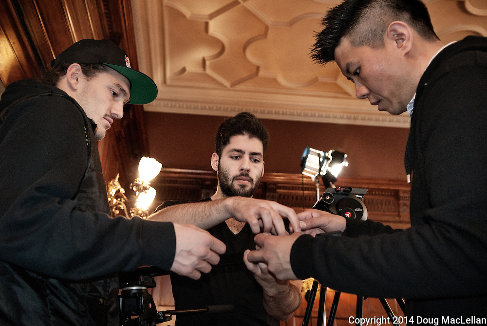 Two students discuss a camera and lens combination with their professor during the production of a music video made as part of their studies at the University of Windsor Department of Communications, Meida and Film.