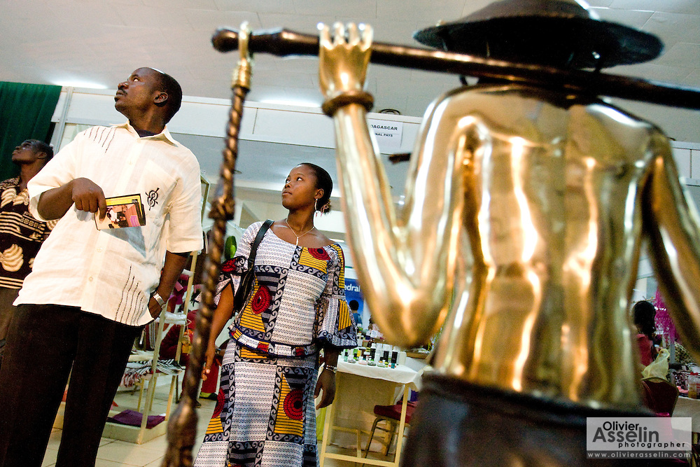 Visitors browse through stands at the 22nd Salon International de l'Artisanat de Ouagadougou (SIAO) in Ouagadougou, Burkina Faso on Saturday November 1, 2008.