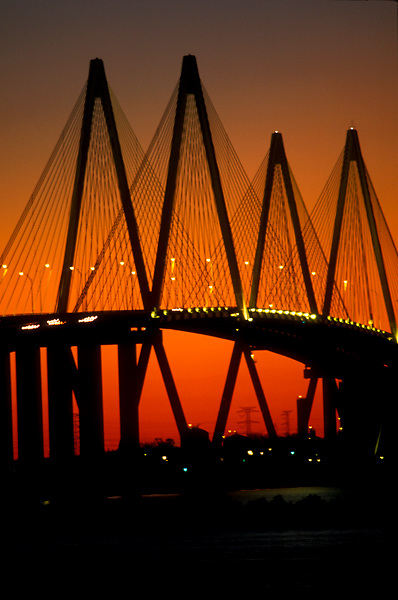 Silhouette of the Fred Hartman Bridge at the Port of Houston at sunset