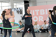 Celebrity trainer and Fitbit Ambassador Harley Pasternak leads #FitbitForAll workouts at the Fitbit launch event in New York, Monday, March 12, 2018. Fitbit unveiled its second smartwatch, Fitbit Versa, and first-ever device for kids, Fitbit Ace, along with the Fitbit family account and female health tracking. The newest devices and features from Fitbit support the company's vision of making the world healthier, while reaching more people in unique ways to continue to help them achieve their health and fitness goals. (Photo by Diane Bondareff/AP Images for Fitbit)