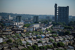 © Licensed to London News Pictures. 14/06/2017. London, UK. A view over the rooftops of Notting Hill in west London showing the Trellick Tower building (right). Photo credit: Ben Cawthra/LNP