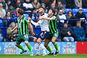 Bolton Wanderers striker Gary Madine (14)  challenges with AFC Wimbledon defender Will Nightingale (5)  during the EFL Sky Bet League 1 match between Bolton Wanderers and AFC Wimbledon at the Macron Stadium, Bolton, England on 4 March 2017. Photo by Simon Davies.