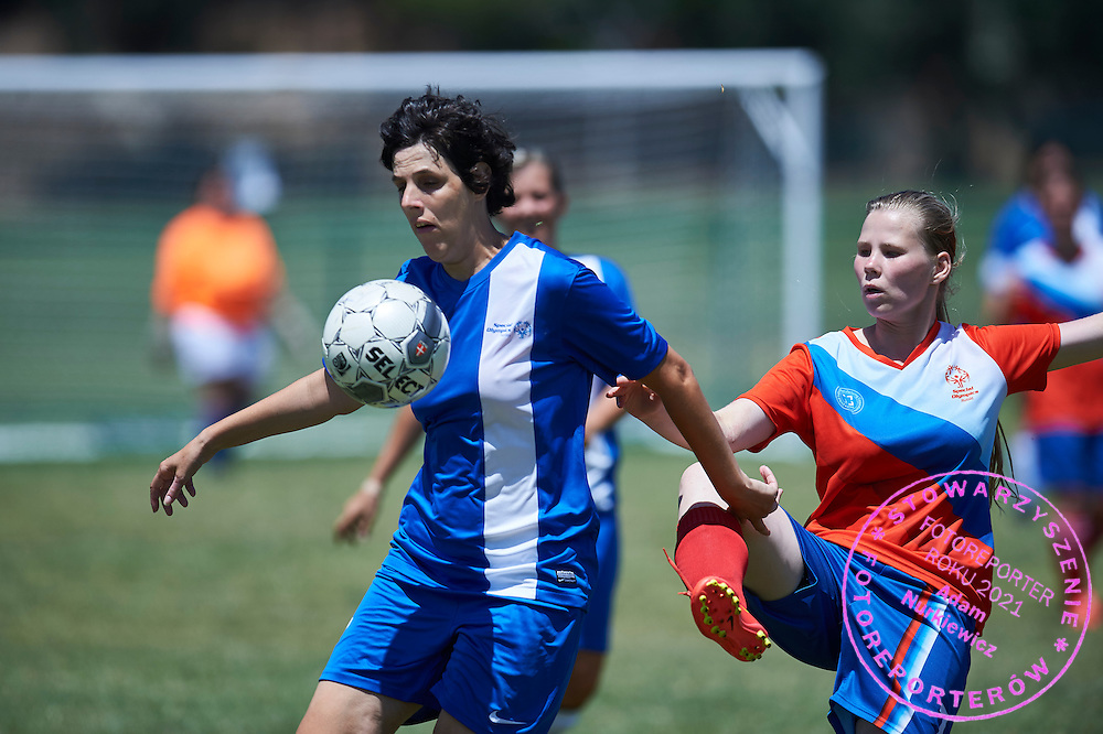 SO Russia athlete (L) fights for the ball with SO Greece athlete (R) while football women match 7-a-side during fourth day of the Special Olympics World Games Los Angeles 2015 on July 28, 2015 at Balboa Sports Centre in Los Angeles, USA.<br /> USA, Los Angeles, July 28, 2015<br /> <br /> Picture also available in RAW (NEF) or TIFF format on special request.<br /> <br /> For editorial use only. Any commercial or promotional use requires permission.<br /> <br /> Adam Nurkiewicz declares that he has no rights to the image of people at the photographs of his authorship.<br /> <br /> Mandatory credit:<br /> Photo by &copy; Adam Nurkiewicz / Mediasport