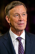 Democratic presidential candidate and former Colorado Governor John Hickenlooper speaks with the press after participating in the first primary debate for the 2020 elections at the Adrienne Arsht Center for the Performing Arts in downtown Miami on Thursday, June 27, 2019.