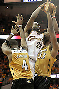 Washington Wizards forward Antawn Jamison (L) and teammate Brendan Haywood (R) try to stop Cleveland Cavaliers forward LeBron James (C) during the fourth quarter of their game at the Quicken Loans Arena in Cleveland, Ohio, USA,19 April 2008. The Cavaliers beat the Wizards 93-86 during the first game of the Eastern Conference first round play-offs.
