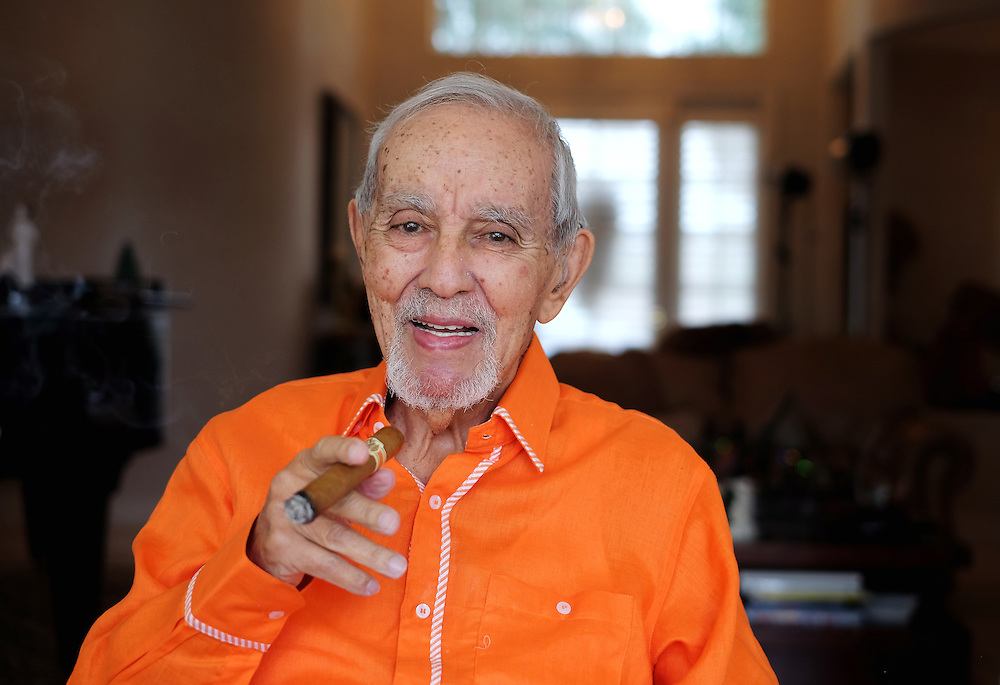 Avo Uvezian, 89, renowned cigar maker photographed at his Orlando home on on December 18, 2015. In addition to his fine cigars, Uvezian studied at The Juilliard School, is a musician and composer and speaks 9 languages. (Jacob Langston for the New York Times)