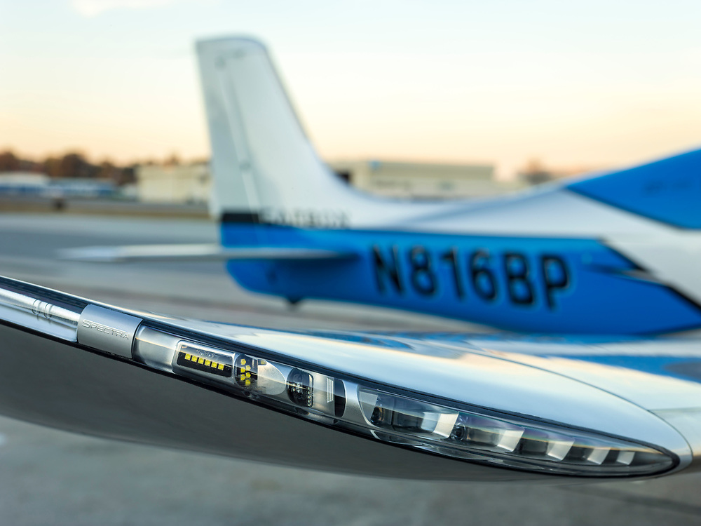 LED wing lighting of a Cirrus SR22T GTS.  <br /> <br /> Created by aviation photographer John Slemp of Aerographs Aviation Photography. Clients include Goodyear Aviation Tires, Phillips 66 Aviation Fuels, Smithsonian Air & Space magazine, and The Lindbergh Foundation.  Specialising in high end commercial aviation photography and the supply of aviation stock photography for advertising, corporate, and editorial use.