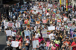 © Licensed to London News Pictures. 13/07/2018. London, UK. Demonstrators march down Haymarket in protest at President Trump's visit. President Trump is on the second day of a four day visit to the UK. Photo credit: Peter Macdiarmid/LNP