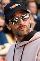 © Licensed to London News Pictures. 05/08/2018. LONDON, UK. Adrian Brody, actor, joins the other entrants. Gumball 3000, a charity rally for supercars and more, including celebrity entrants, begins in Covent Garden with 150 participants beginning their journey from London to Tokyo.  Photo credit: Stephen Chung/LNP
