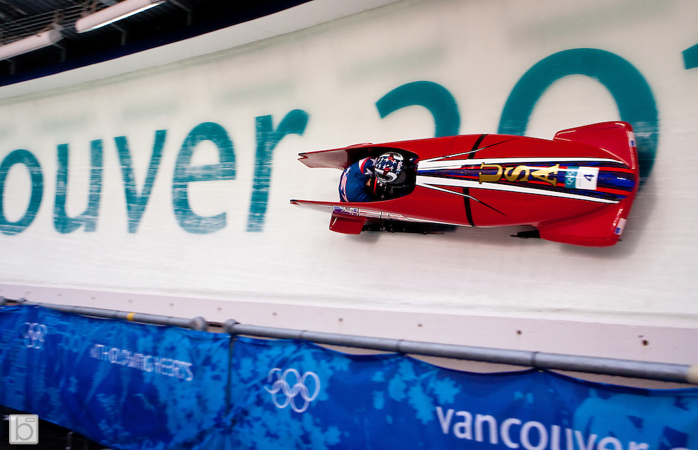 Shauna Robock drives the USA1 woman's bobsled with MIchelle Rzepka on the brakes during the first heat of the 2010 Winter Olympics Woman Bobsled competition at the Whistler Sliding Center in Whistler, BC, Canada. (Photo/Todd Bissonette - www.usabobsledphotos.com)
