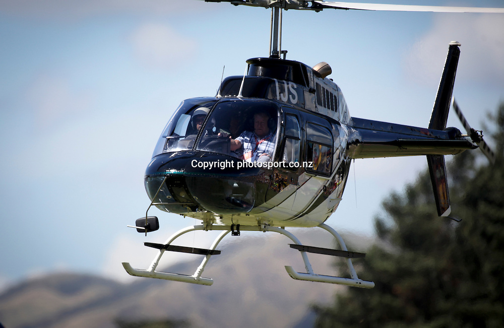 Hilton McCullough and his father and Sir Colin Meads arriving by helicopter before the preseason Super Rugby match between the Hurricanes and the Chiefs, Mangatainoka Rugby Football Club, Mangatainoka,  New Zealand. Saturday, 16 February, 2013. Photo: Bethelle McFedries / photosport.co.nz