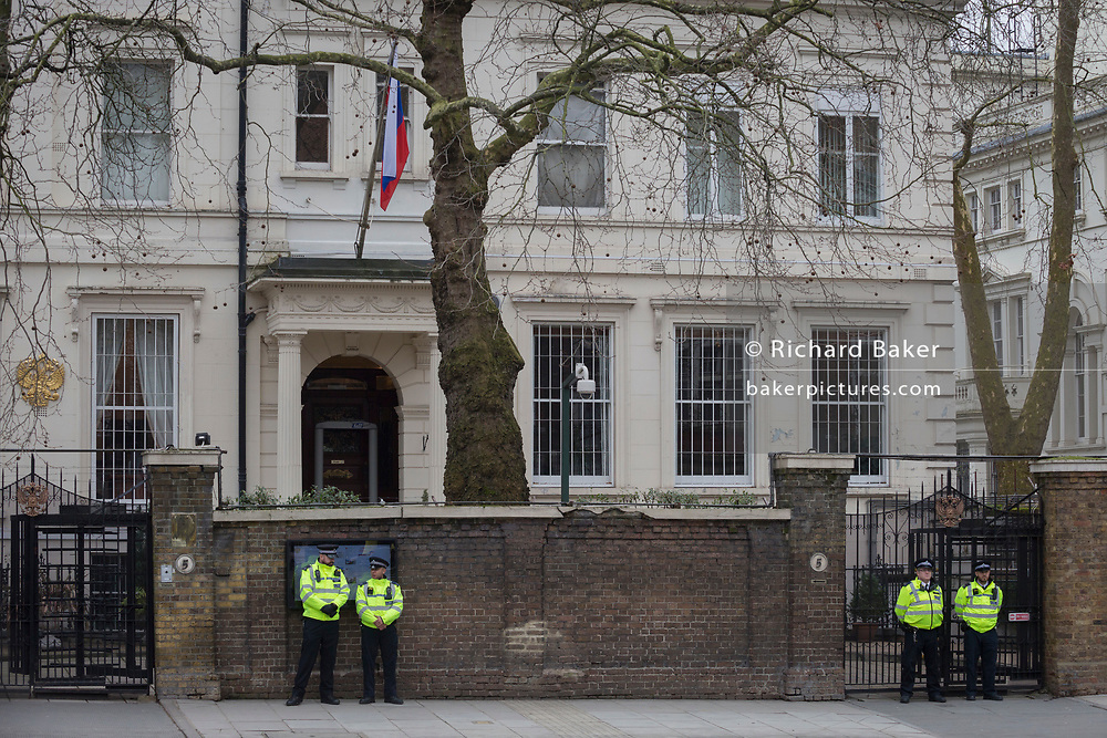 On the day that the British government awaits an explanation from the Kremlin over the poisoning by the nerve gas Novichok in Salisbury of ex-Russian spy Sergei Skripal and his daughter Yulia, Metropolitan police officers stand outside the Russian Federation Embassy and Consulate Section, on 13th March 2018, in London England.