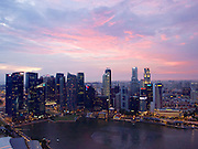 Singapore. Marina Bay Sands Hotel. Sunset view over Marina Bay and the downtown skyline.