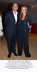 INDIA HICKS and DAVID FLINT WOOD at a party in London on 7th July 2004.PXA 28