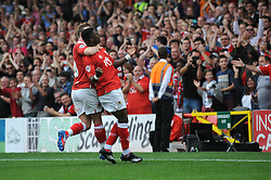 Bristol City's Kieran Agard celebrates his goal with Bristol City's Wade Elliott - Photo mandatory by-line: Dougie Allward/JMP - Mobile: 07966 386802 - 27/09/2014 - SPORT - Football - Bristol - Ashton Gate - Bristol City v MK Dons - Sky Bet League One