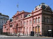"Built in the late 1800s, La Casa Rosada (The Pink House) is the iconic official executive mansion and office of the President of Argentina (or ""Presidency of the Argentine Nation""), in Buenos Aires, South America. The baby pink palatial mansion is known officially as ""Casa de Gobierno"" which means ""House of Government"". The President normally lives at the Quinta de Olivos, in Olivos, Buenos Aires Province. The Casa Rosada is a National Historic Monument of Argentina, contains a museum of presidents' memorabilia, and is at the eastern end of the Plaza de Mayo. The Plaza de Mayo took its modern form in 1884 but has been at the political center of Buenos Aires since the city's foundation in 1580."