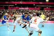 DESCRIZIONE : Handball Jeux Olympiques Londres Quart de Finale<br /> GIOCATORE : Pineau Allison FRA Lazovic Suzana MNE<br /> SQUADRA : France Femme<br /> EVENTO : FRANCE Handball Jeux Olympiques<br /> GARA : France Montenegro<br /> DATA : 08 08 2012<br /> CATEGORIA : handball Jeux Olympiques<br /> SPORT : HANDBALL<br /> AUTORE : JF Molliere <br /> Galleria : France JEUX OLYMPIQUES 2012 Action<br /> Fotonotizia : France Handball Femme Jeux Olympiques Londres Quart de Finale Copper Box<br /> Predefinita :