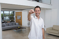 Man holding key in new home portrait