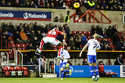 Swindon Town's Jonathan Obika leaps to head the ball during the Sky Bet League 1 match between Swindon Town and Walsall at the County Ground, Swindon, England on 24 November 2015. Photo by Shane Healey.