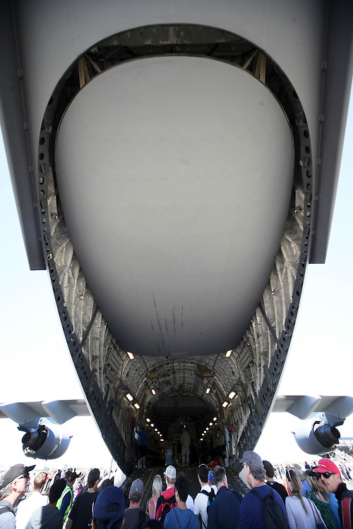 Crowds line up to see inside a USAF C17 Globemaster in the 75th Anniversary Airshow at Ohakea Airforce base, New Zealand, Saturday, 31 March, 2012. Credit:SNPA / John Cowpland