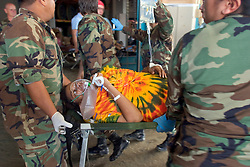 30 August, 2005. New Orleans Louisiana. Hurricane Katrina aftermath. <br /> A pregnant woman goes into labour at the makeshift hospital triage unit set up at the Superdome in New Orleans following her rescue from the flooded lower 9th ward. <br /> Photo Credit: Charlie Varley/varleypix.com