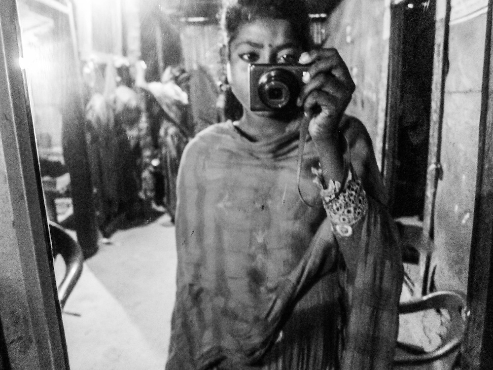 The Mirror and I, Bangladesh, by Nargis. <br /> <br /> Nargis is 13 years old, and makes and sells jewellery on the beach. She was the last of the girls to join the Surfing club, but has picked up on skating very quickly. She loves music, and always carries around a sound box with her while she is working.
