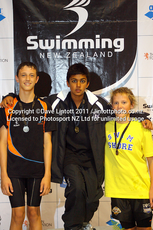 14yo Boys 100m breastsroke podium, from left, Ben Walsh (2), Bradley Arona-Waqanivavalagi (1) and Jacob Garrod (3). New Zealand Age Group Swimming Championships day five at Welllington Aquatics Centre, Kilbirnie, Wellington, New Zealand on Saturday, 5 March 2011. Photo: Dave Lintott / photosport.co.nz