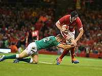 Rugby - 2019 pre-Rugby World Cup warm-up (Under Armour Summer Series) - Wales vs. Ireland<br /> <br /> Jake Ball, of Wales tackled by Garry Ringrose, of Ireland, at Principality (Millennium) Stadium.<br /> <br /> COLORSPORT/WINSTON BYNORTH