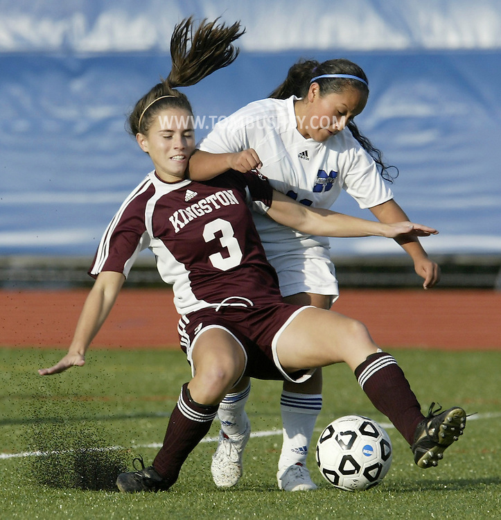 Kingston's Taylor Thompson (3) battles Middletown's Jessica Aguilar for the ball during a game in Middletown on Wednesday, Oct. 21, 2009.