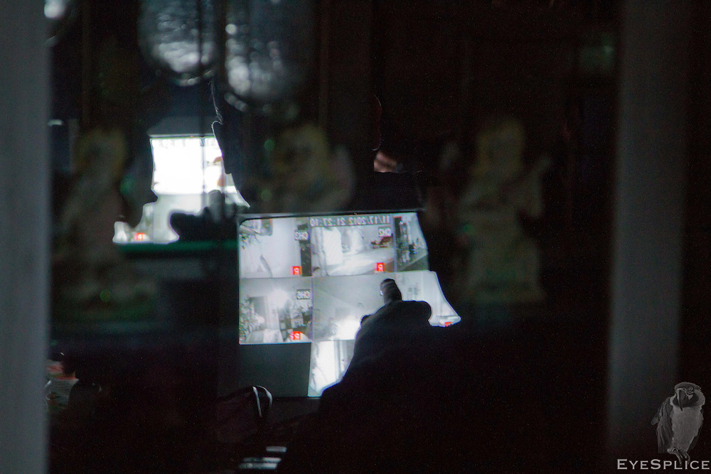 Father Hall watches the surveillance cameras during an investigation at a private residence in  San Antonio, Texas. He is looking for any unusual movements, orbs, or shadows. If he notices something suspicious he then writes down the time and camera. Later on, the Woodlands Paranormal group will review the footage at the times he has noted in order to determine if there really was paranormal activity occurring.