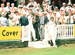Members of the South African cricket team recieve a standing ovation as they walk on to the pitch at Lord's. Headed by Gary Kirsten (R) and Andrew Hudson. It is the first day of test cricket for their country in England for 29 years.