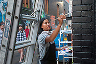 Nichimar Pannarat works on her mural in the evening of August 5, 2017 during the Freak Alley Gallery seventh annual mural event in downtown Boise, Idaho.<br /> <br /> Freak Alley Gallery's week long event provided an &quot;art-in-motion&quot; experience as it welcomed the public to watch artists work on their murals.