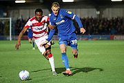 AFC Wimbledon striker Joe Pigott (39) battles for possession during the EFL Sky Bet League 1 match between AFC Wimbledon and Doncaster Rovers at the Cherry Red Records Stadium, Kingston, England on 14 December 2019.