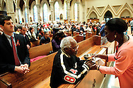 "Martine Monney (R) shares communion with Michael Herard during the 78th Annual Votive Mass of the Holy Spirit, or ""Red Mass"" is celebrated at Holy Name Cathedral in Chicago. September 30, 2012 l Brian J. Morowczynski~ViaPhotos..For use in a single edition of Catholic New World Publications, Archdiocese of Chicago. Further use and/or distribution may be negotiated separately. Contact ViaPhotos at 708-602-0449 or email brian@viaphotos.com."