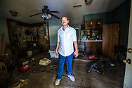 Sept. 2, 2016 Frank Bonifay inside his flooded home about 20 miles south of Baton Rouge, Louisiana.