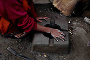 Daughter of Imam Hussain is making a hearth to prepare food in their makeshift camp at the outskirts of Delhi State of India. More than 10,000-numbers of Burmese Rohingya Muslim refugee took shelter in Indian (Hyderabad) Andhra Pradesh, (Mewat) Haryana, (Kanchankunj) Delhi and Jammu States after ethnic strife between Rohingya Muslims and Buddhists that had been started since 1940s. Still so many peoples of aforesaid community have been living at various refugee camps in Myanmar, Bangladesh and India chiefly. Rohingya Muslims of Buthidaung, Rathedaung and Sittwe of Rakhine (formerly, Arakan) State, who ran away from Myanmar (that is, Burma) to Bangladesh to India and others South-Asian countries to escape socio-political-religious violence. (Photo/Shib Shankar Chatterjee)