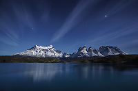 Full moon glow on Paine Grande and Los Cuernos reflecting in Lago Pehoe, Torres del Paine National Park, Chile