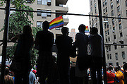 Young people seeking a better vantage point on 5th Avenue to watch the 2008 Pride Parade in New York City.