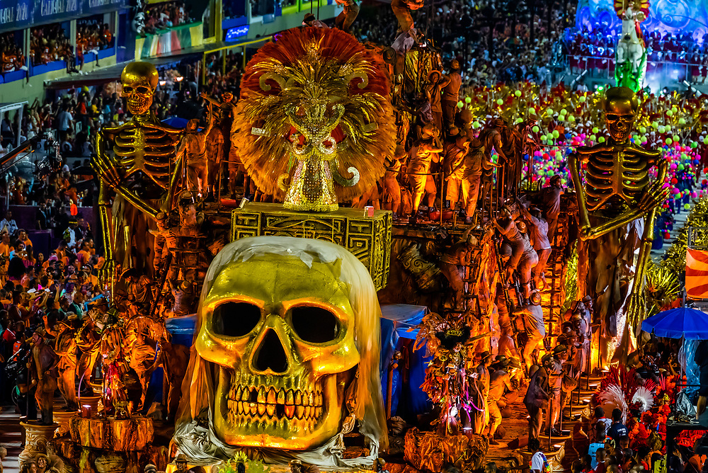 """Floats in the Carnaval parade of Estacio de Sa samba school in the Sambadrome, Rio de Janeiro, Brazil.            The theme  of their parade is """"Stones"""" which includes a 2001:A Space Odyssey type scene with cavemen watching a rock open into a spacecraft with astronauts coming out."""