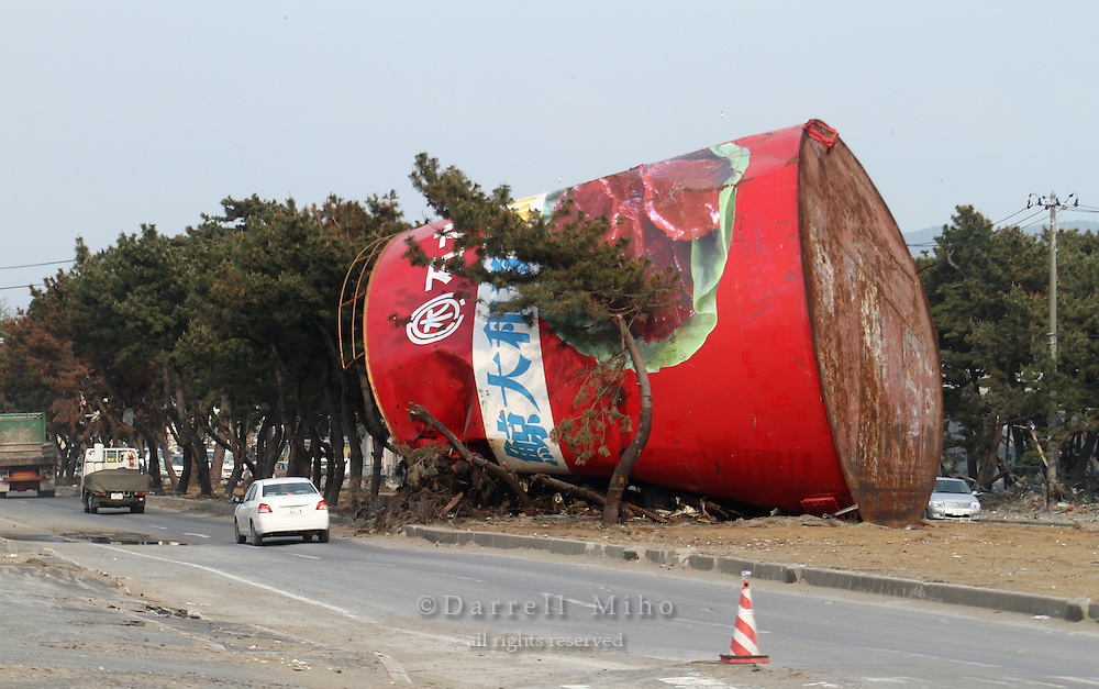 May 17, 2011; Ishinomaki, Miyagi Pref., Japan - A large storage tank sits on the center median after the magnitude 9.0 Great East Japan Earthquake and Tsunami that devastated the Tohoku region of Japan on March 11, 2011...The water tank which had been painted to look like a can of stewed whale meat at Kinoya Ishinomaki Suisan. The seafood company is selling cans of its products which were buried in the mud, with the proceeds to go toward rebuilding its business.