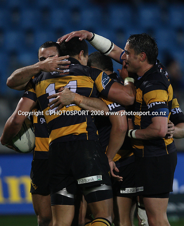 Taranaki players celebrate scoring a try.<br /> Air NZ Cup, Otago v Taranaki, Carisbrook, Dunedin, Friday 19 September 2008. Photo: Rob Jefferies/PHOTOSPORT