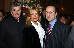 Left to right, ASHLEY BRODIN, his wife model JILLY JOHNSON and MR PAUL McKENNA at The Business Winter Party hosted by Andrew Neil at The Ritz Hotel, Piccadilly, London on 7th December 2005.<br />