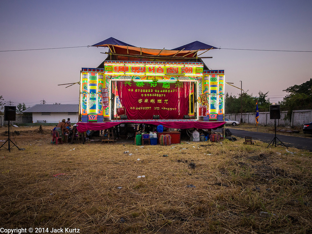 """28 JANUARY 2014 - BANGKOK, THAILAND: The stage for Tear Kia Ee Lye Heng opera troupe before a performance. They were performing for a business in the Min Buri district of Bangkok for the Lunar New Year, which this year is Jan 31. Chinese opera was once very popular in Thailand, where it is called """"Ngiew."""" It is usually performed in the Teochew language. Millions of Teochew speaking Chinese emigrated to Thailand (then Siam) in the 18th and 19th centuries and brought their cultural practices with them. Recently the popularity of ngiew has faded as people turn to performances of opera on DVD or movies. There are still as many 30 Chinese opera troupes left in Bangkok and its environs. They are especially busy during Chinese New Year when they travel from Chinese temple to Chinese temple performing on stages they put up in streets near the temple, sometimes sleeping on hammocks they sling under their stage. They are also frequently hired by Chinese owned businesses to perform as a form of merit making.    PHOTO BY JACK KURTZ"""